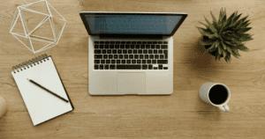 Laptop, notepad, coffee